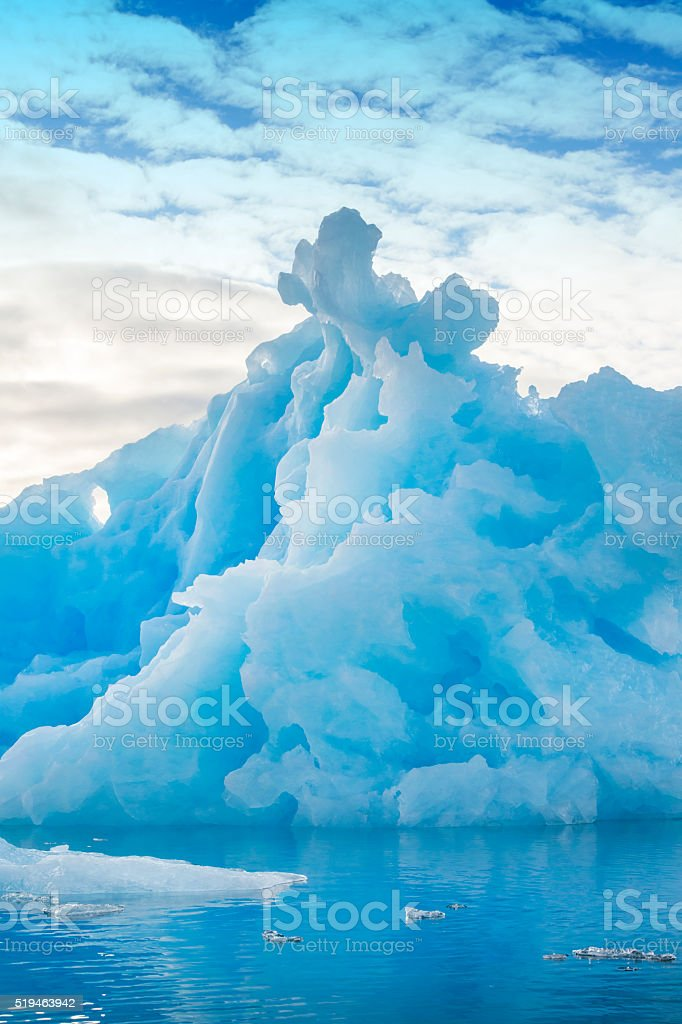 Bizarre shaped iceberg in the arctic sea - XXL image stock photo