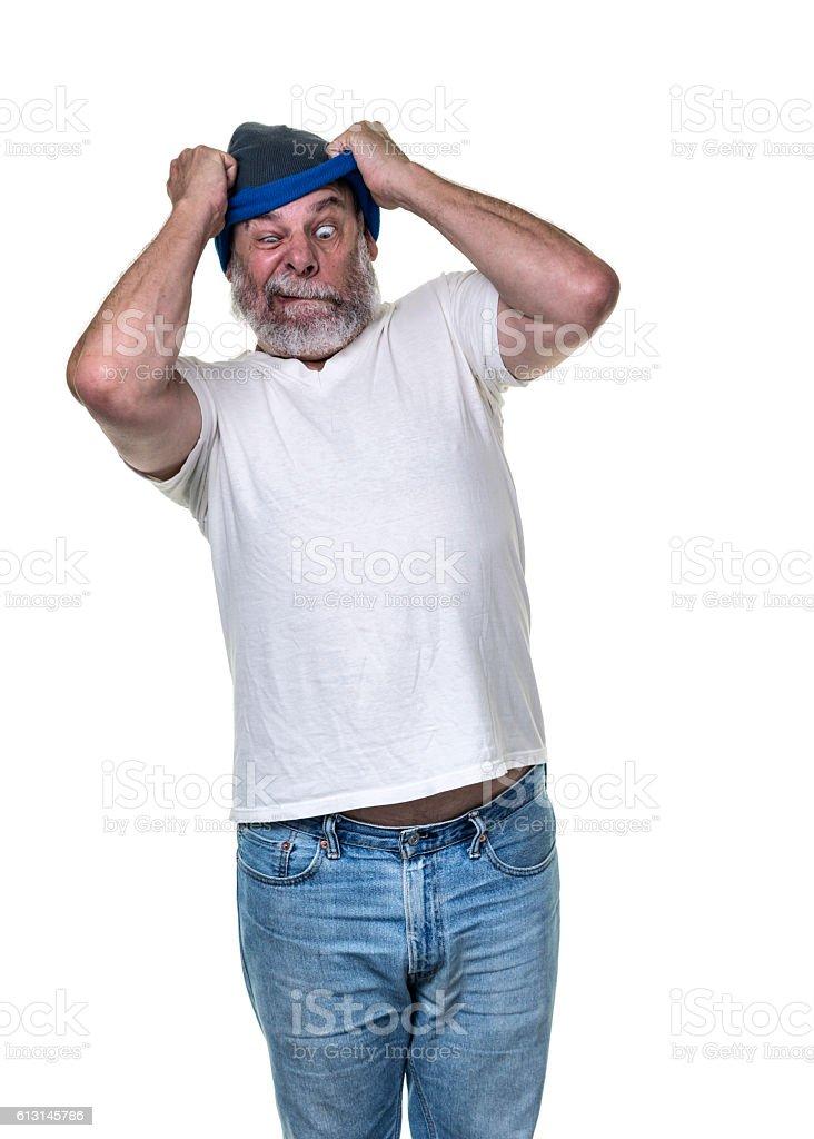 Bizarre Stressed Senior Adult Man Desperately Pulling Knit Cap stock photo