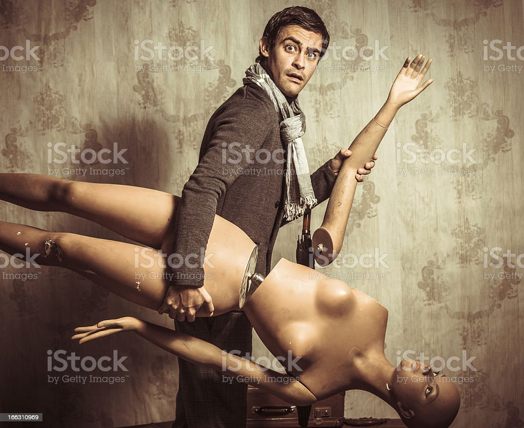 Bizzarre Retro Man with Broken Mannequin royalty-free stock photo