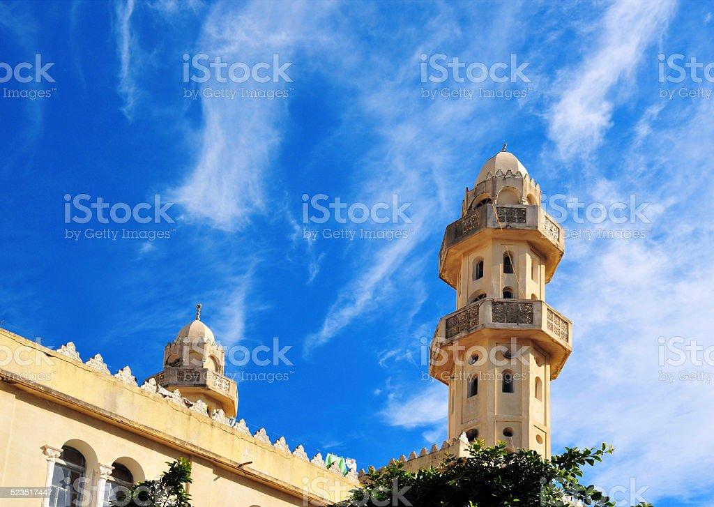 Béjaïa, Algeria: Sidi El Mouhoub mosque minarets and sky stock photo