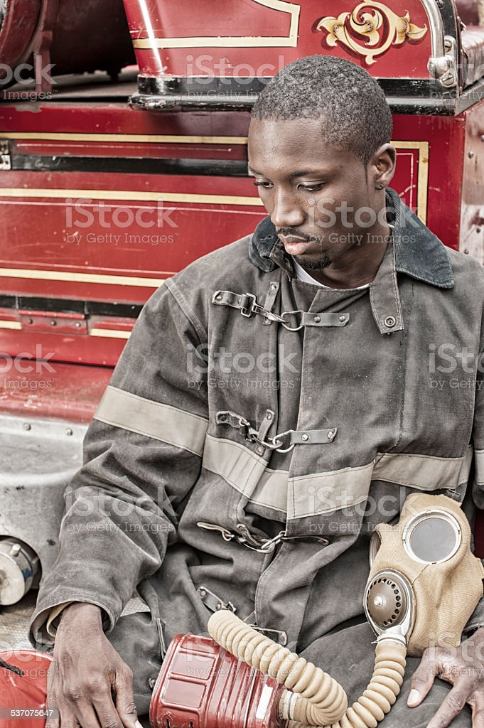 Black African American Firefighter From 1940 to 1960, Fire Truck. stock photo