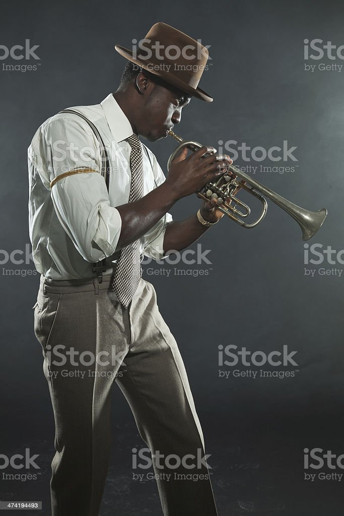 Black african american jazz trumpet player. Vintage. Studio shot. stock photo