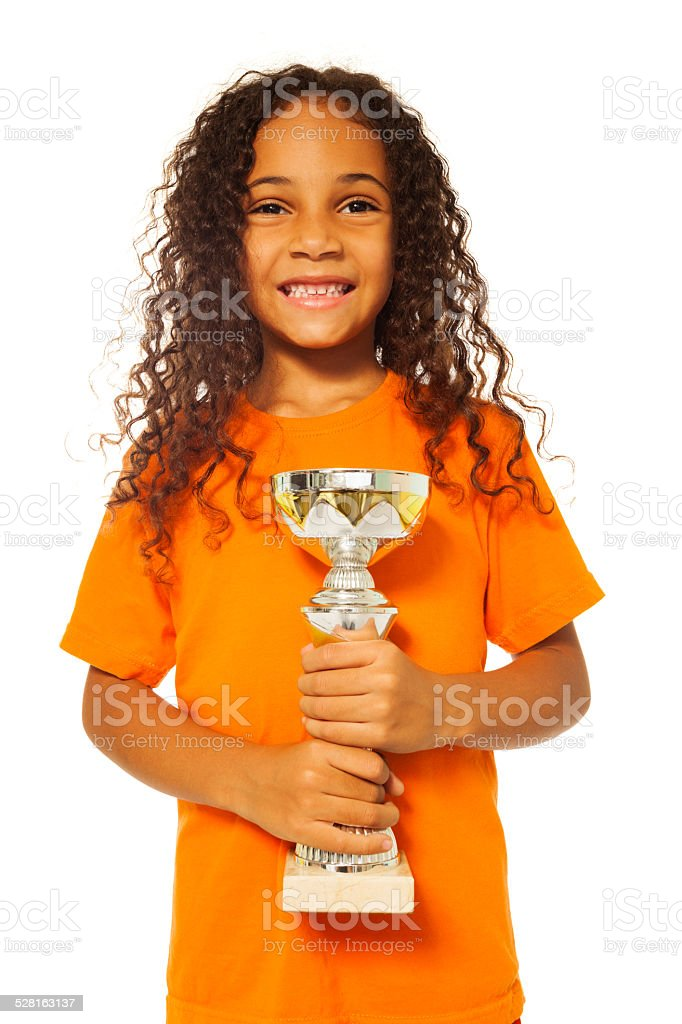 Black African girl with winners cup prize stock photo