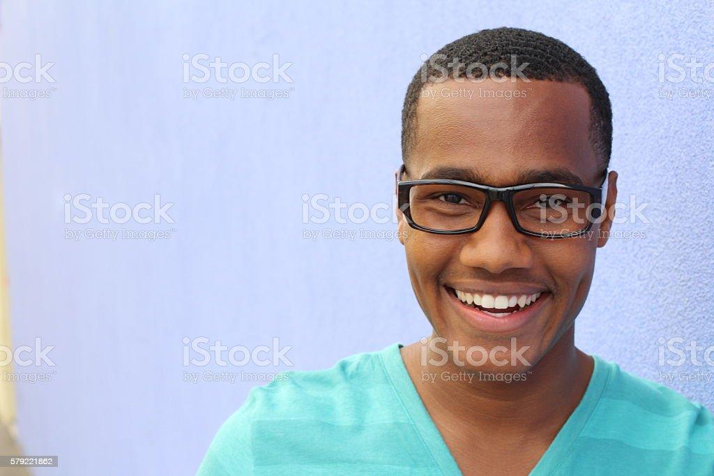 Black African man posing wearing glasses stock photo