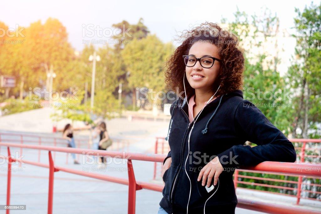 Black afro-american girl listening to music stock photo