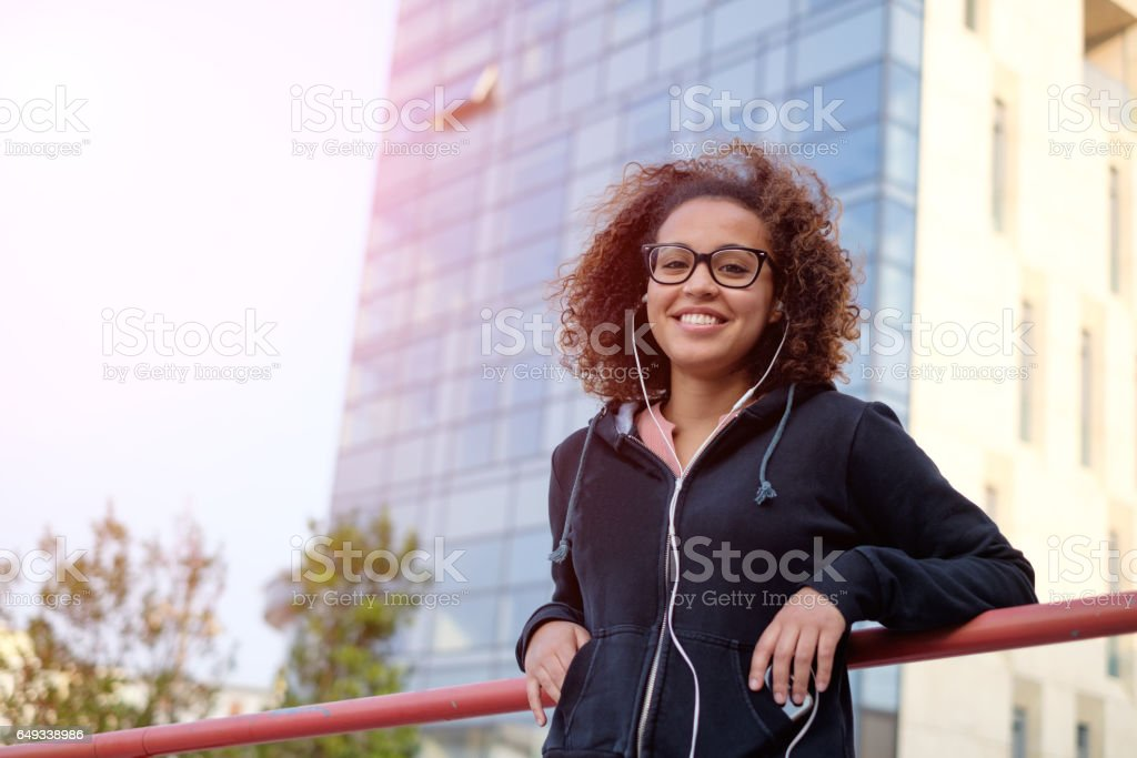 Black afro-american woman using mobile phone stock photo