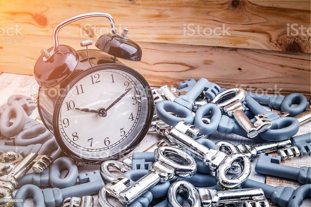 black alarm clock with heaps of keys stock photo