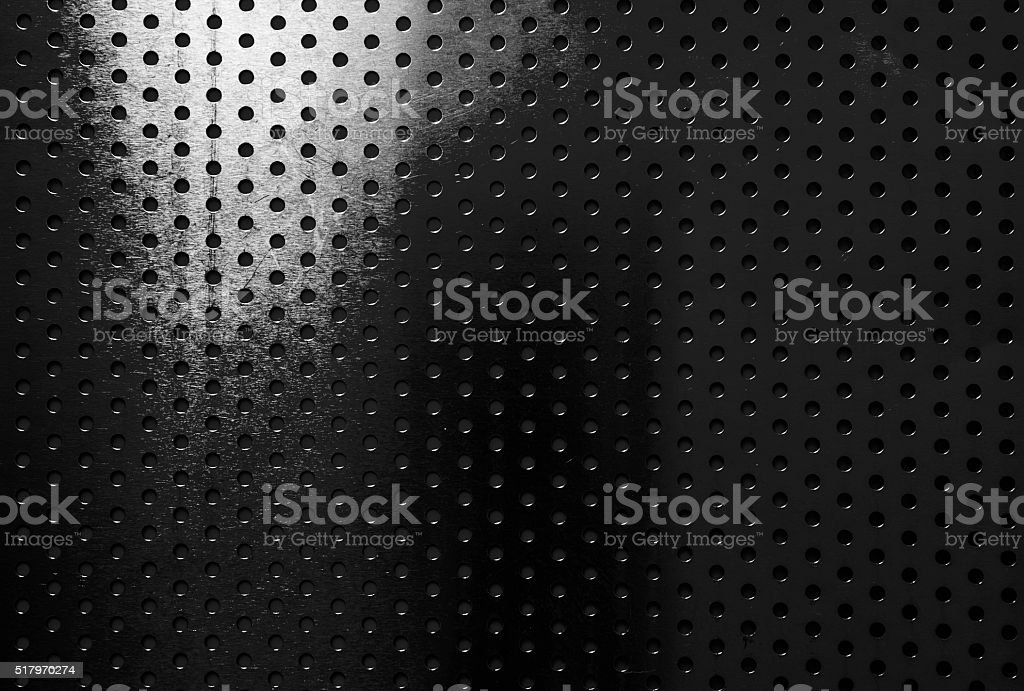 Black aluminum with circle patterns texture background stock photo