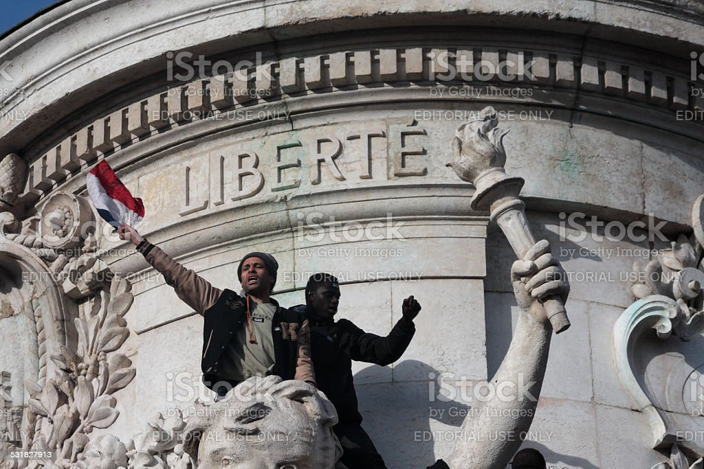 Black and arab people singing the Marseillaise in Paris stock photo
