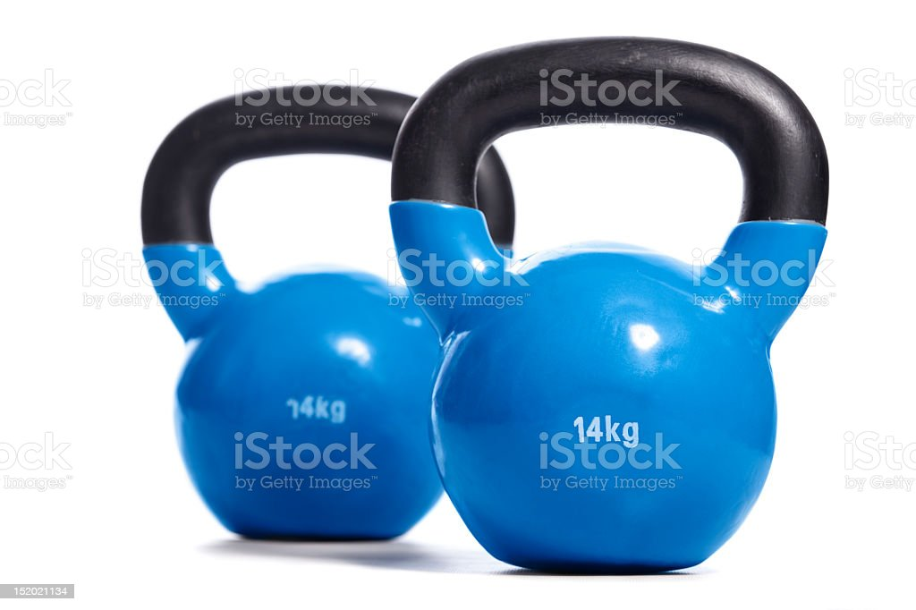 Black and blue 14kg kettle balls on a white background royalty-free stock photo
