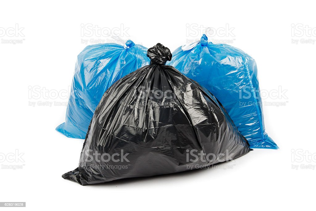 Black and blue garbage bags stock photo