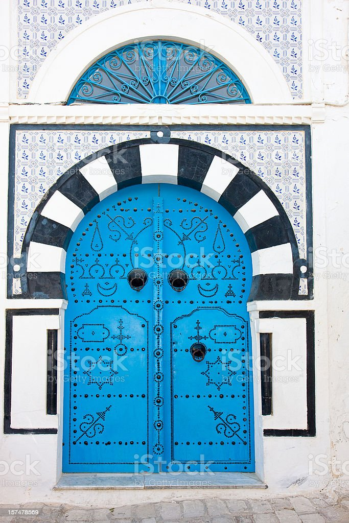 black and blue mediterranean house entrance