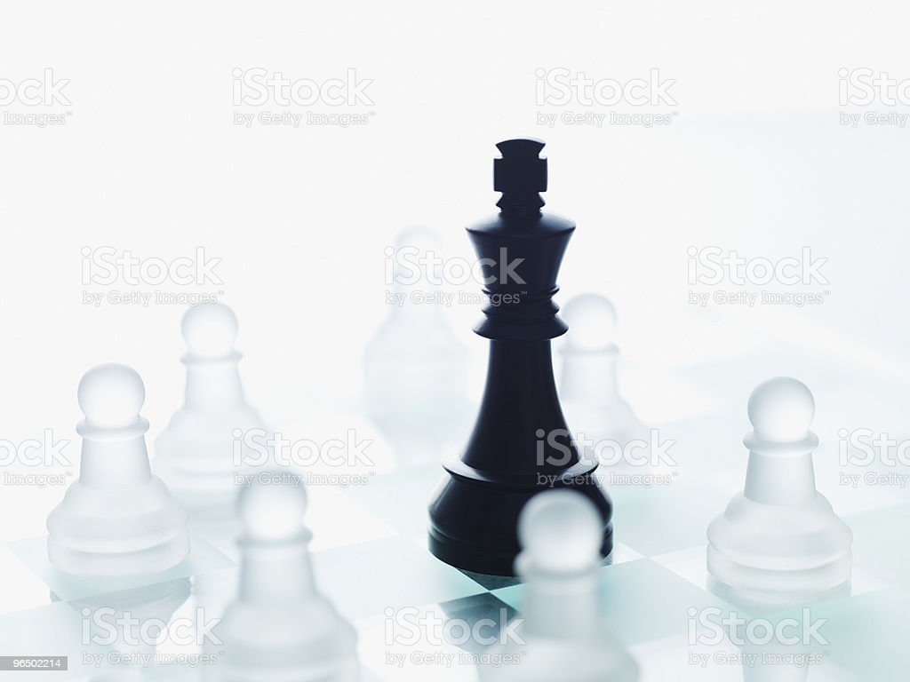 Black and glass chess pieces stock photo