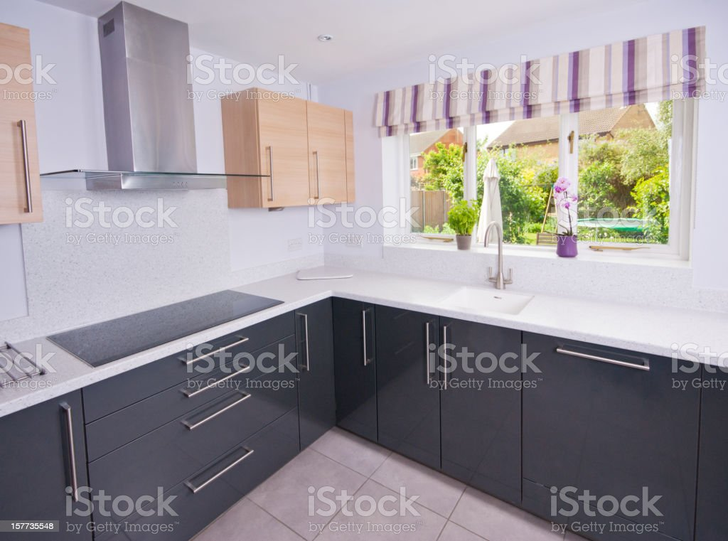A black and gray modern kitchen stock photo