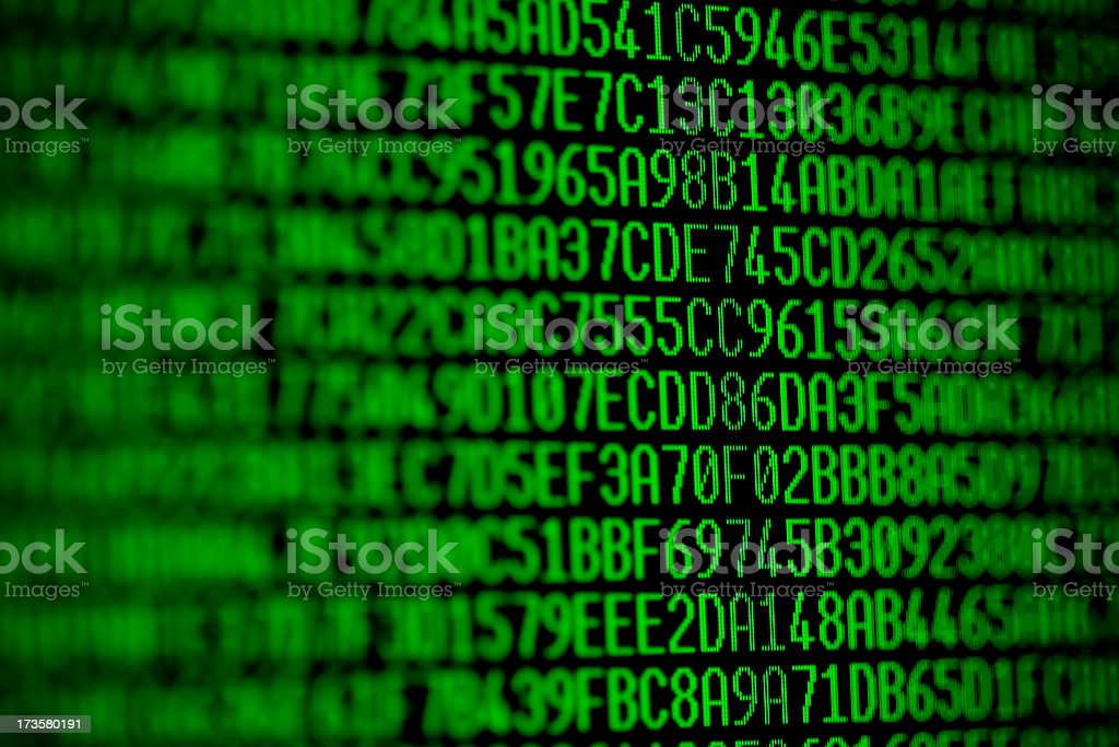 Black and green computer code with numbers and letters stock photo