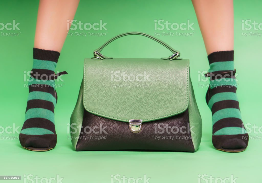 Black and green handbag stock photo