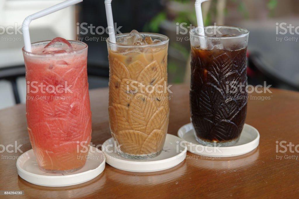 black and milk coffee with tomato juice stock photo