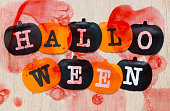Black and orange pumpkins on wooden background