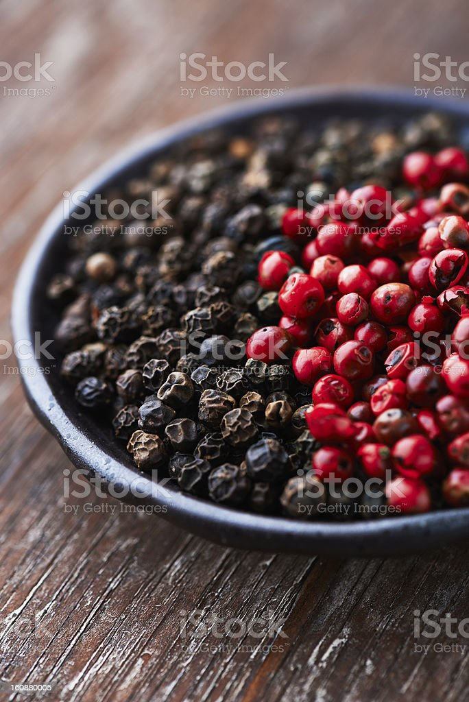 Black and pink peppercorns royalty-free stock photo