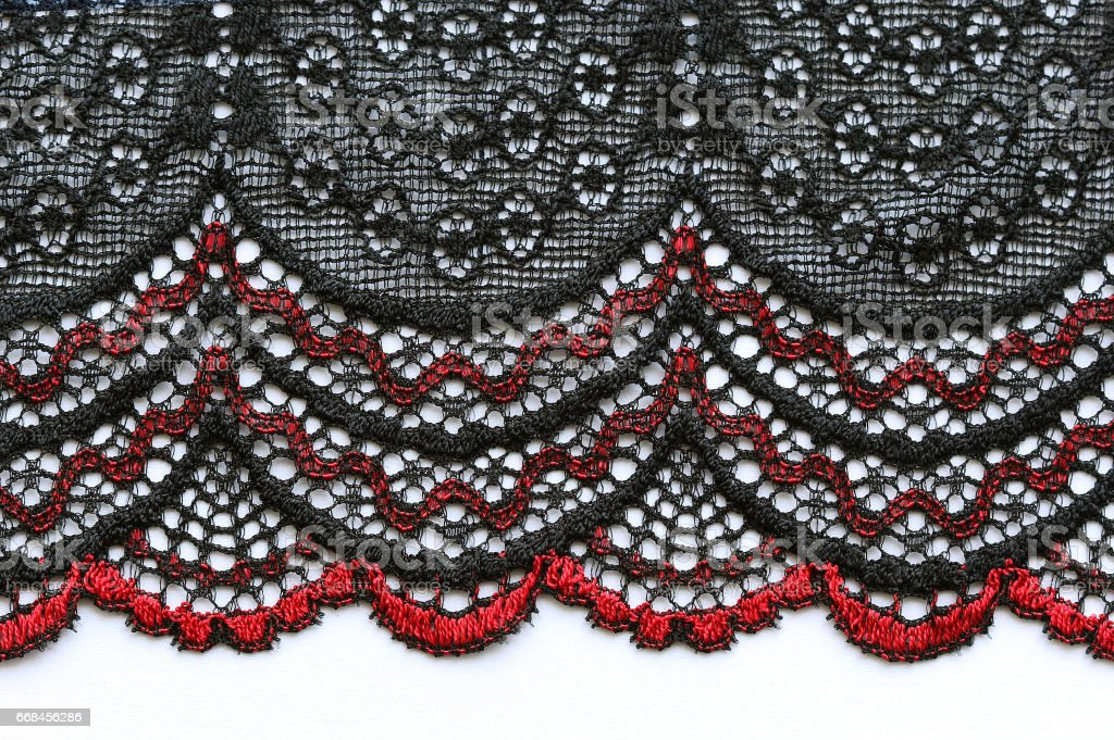 Black and red lace material texture macro shot stock photo