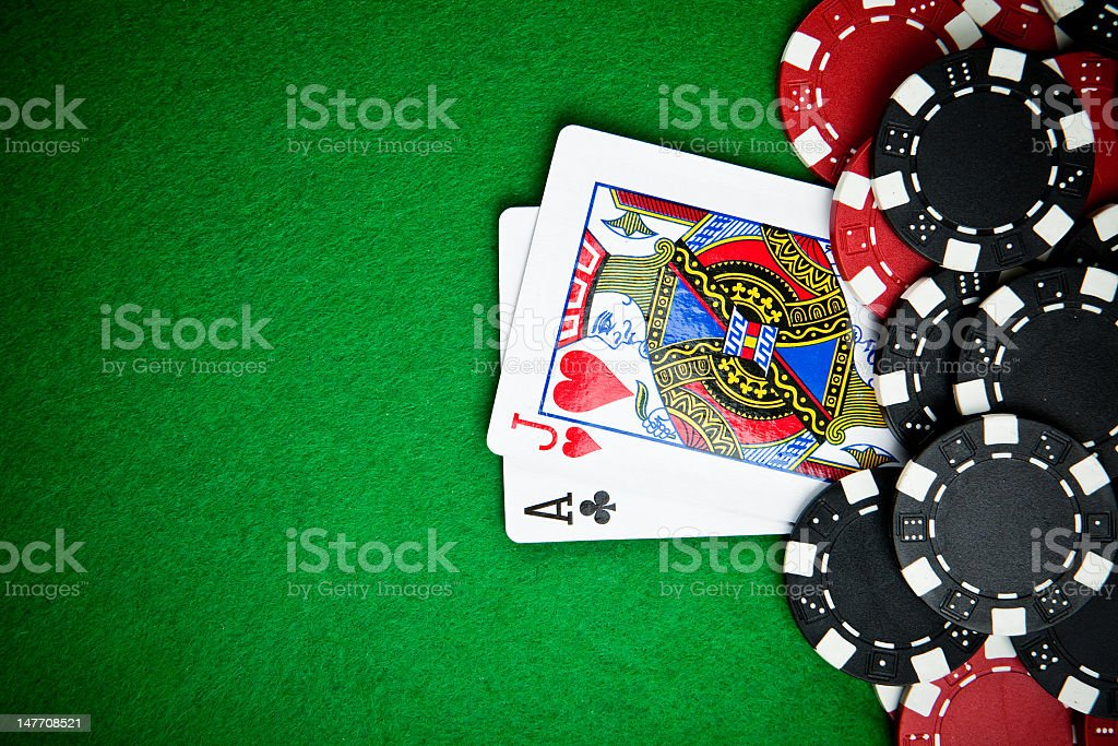 Black and red poker chips in the background. stock photo