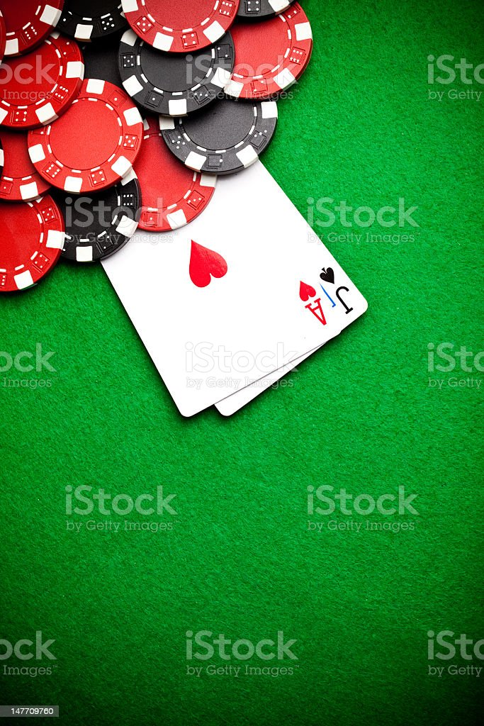 Black and red poker chips in the background stock photo