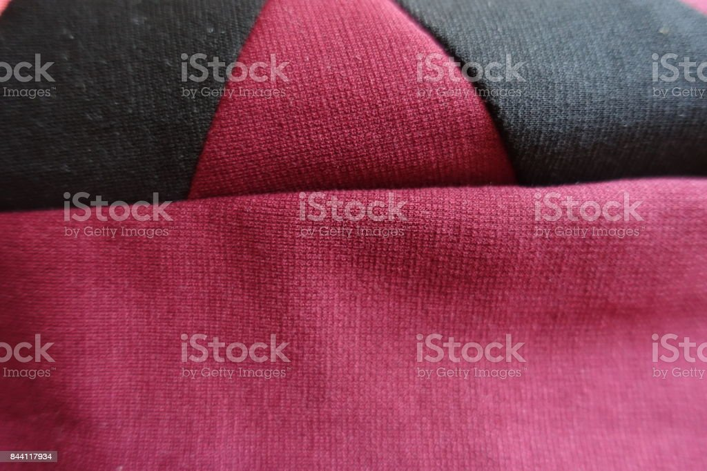 Black and red stockinette fabric stitched together stock photo