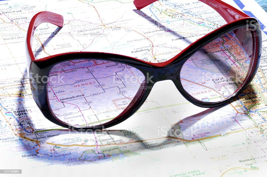 Black and Red Sunglasses Lying on a Map of Florida stock photo