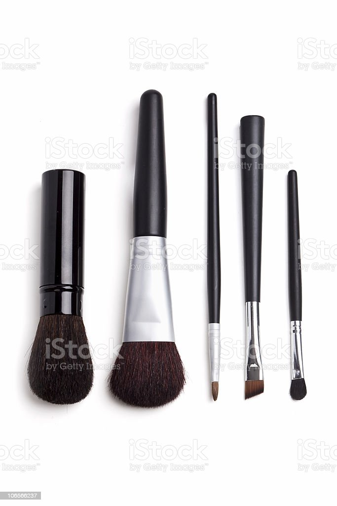 Black and silver cosmetic brushes stock photo