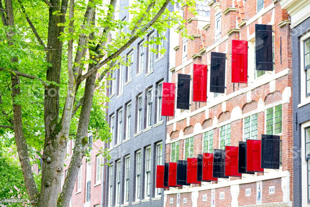 Black and typical red doors open on street in Amsterdam stock photo