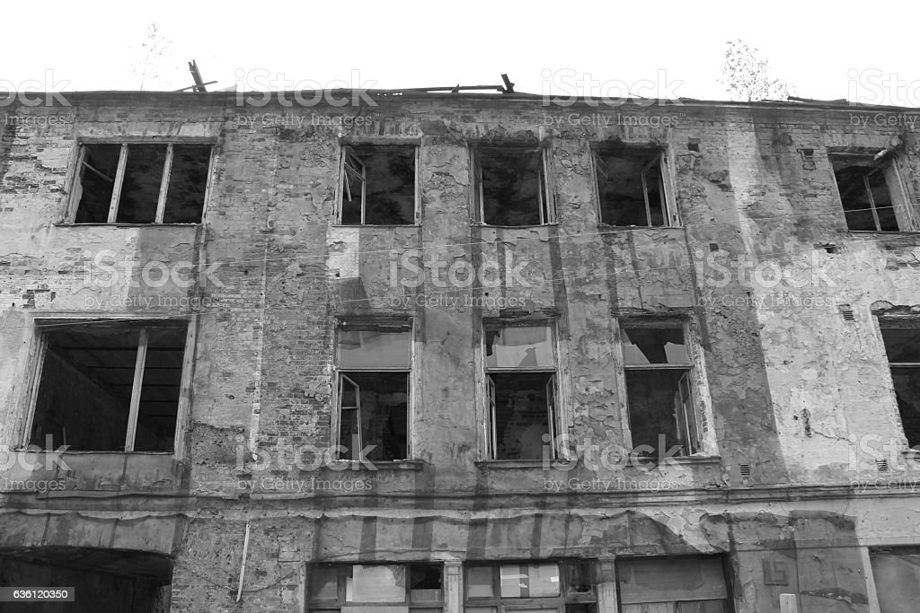 Black and white abandoned destroyed old building facade stock photo