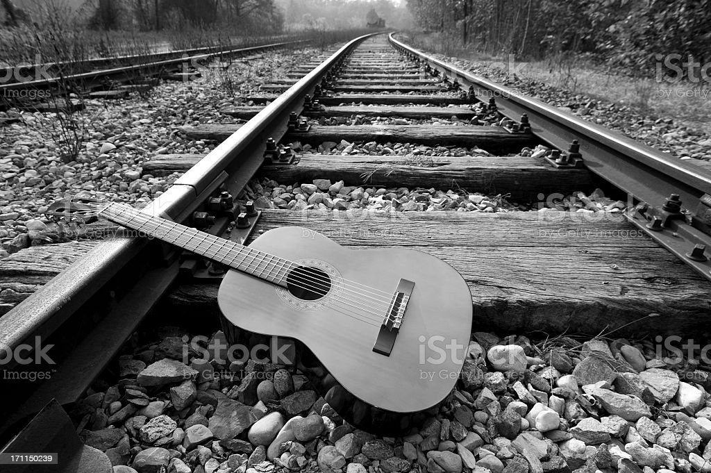 Black And White Abandoned Guitar On The Railway stock photo