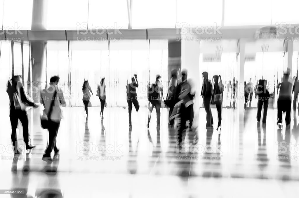 Black and white abstract lobby scene of business people stock photo