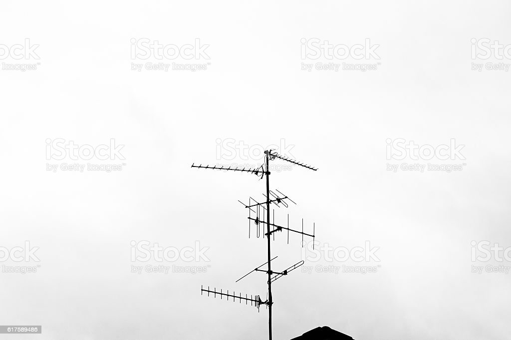 Black and white antenna on roof stock photo