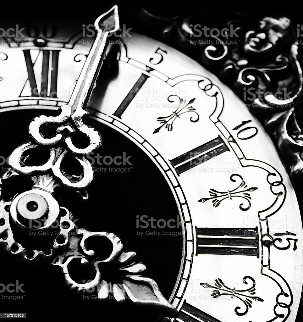 A black and white antique clock royalty-free stock photo