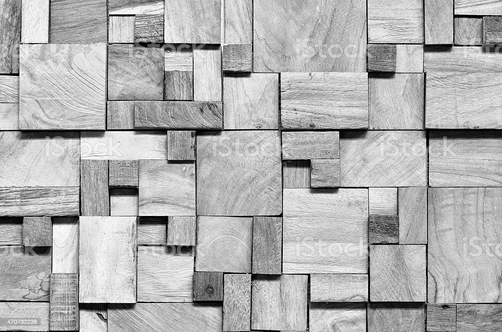 Black and white background of irregularly shaped wooden blocks stock photo