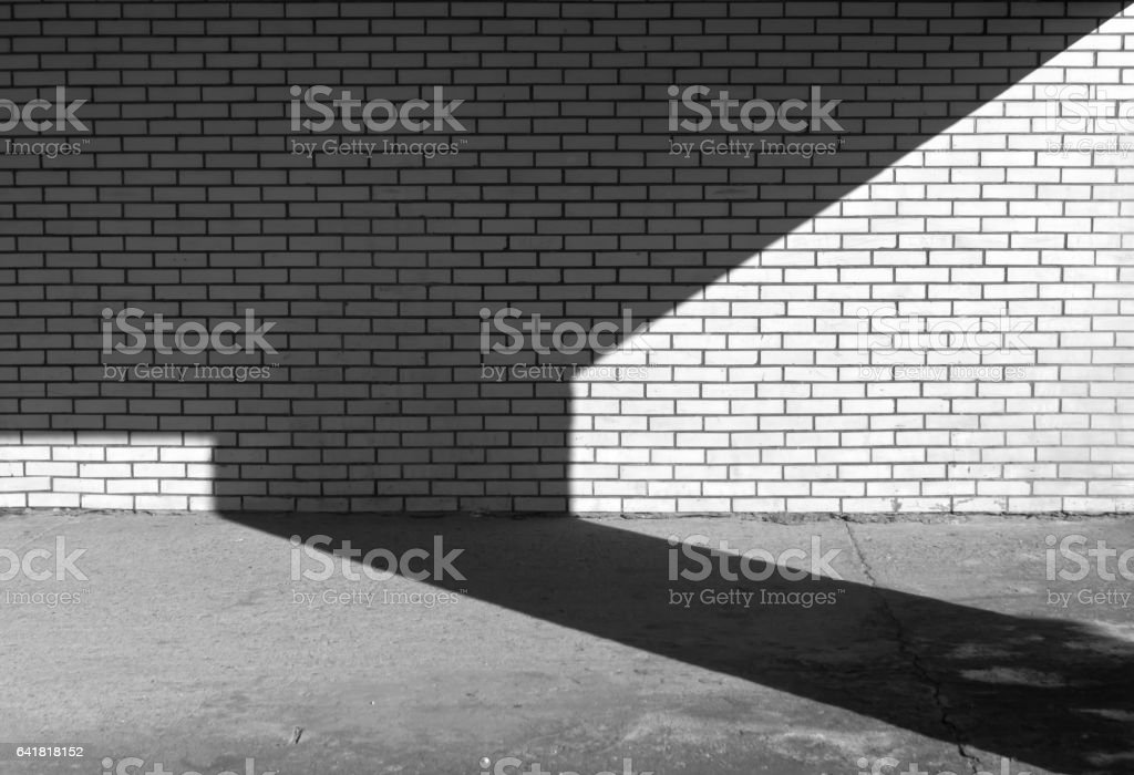Black and white brick wall texture and shadow. stock photo
