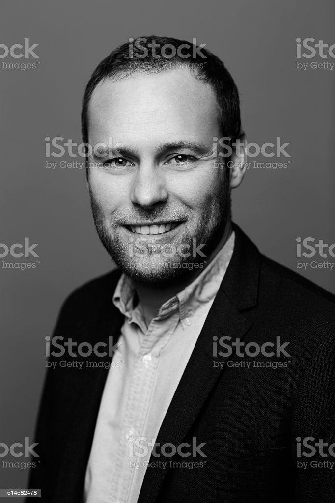 Black and white businessman portrait, smiling stock photo
