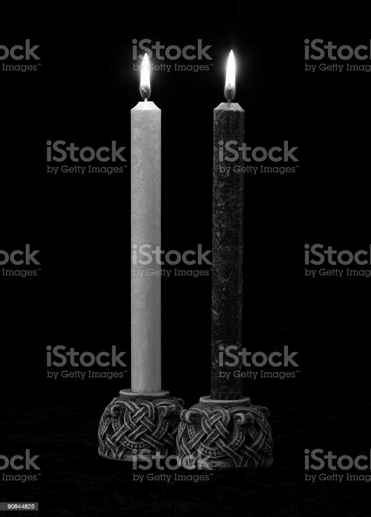 Black and White candles in B&W royalty-free stock photo