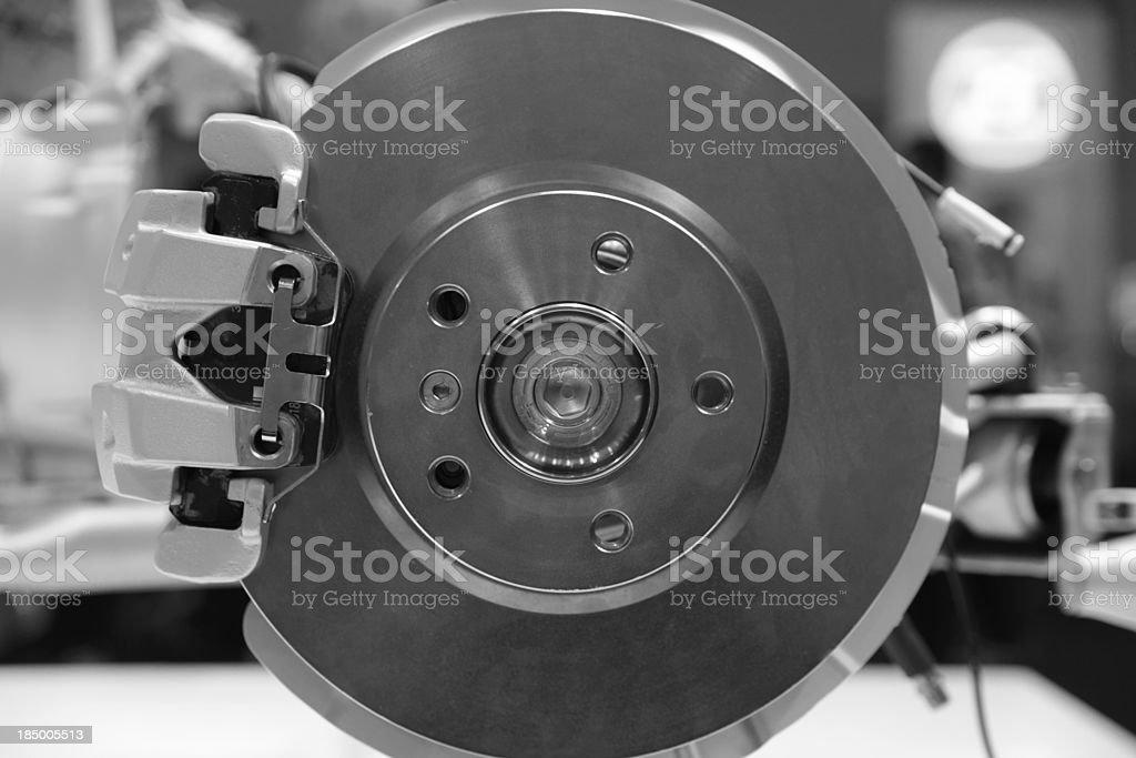 Black and white car brake plus pad macro stock photo