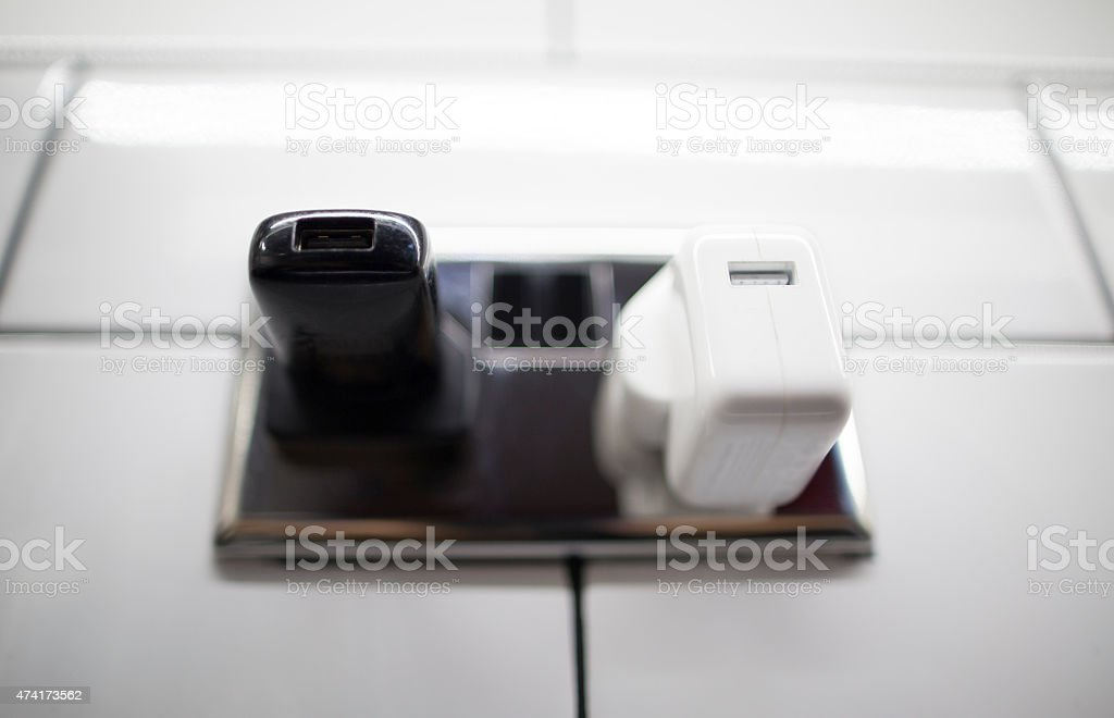black and white charger plug stock photo