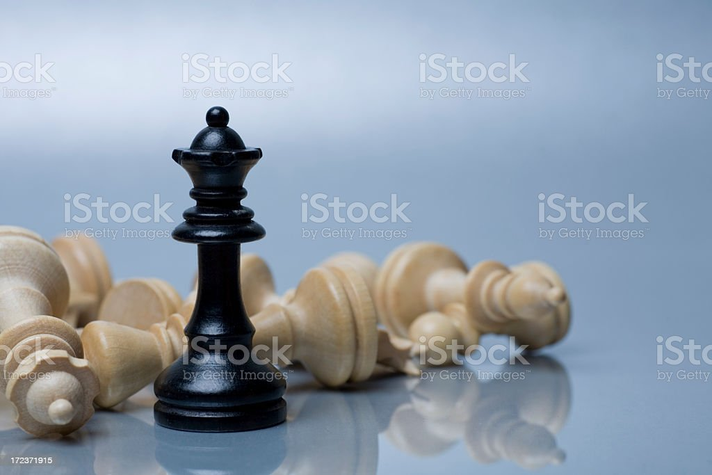 Black and white chess pieces on silver background stock photo