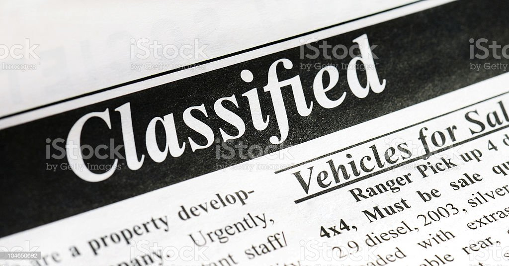 A black and white classified header stock photo