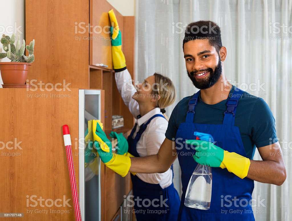 Black and white cleaners at the work stock photo