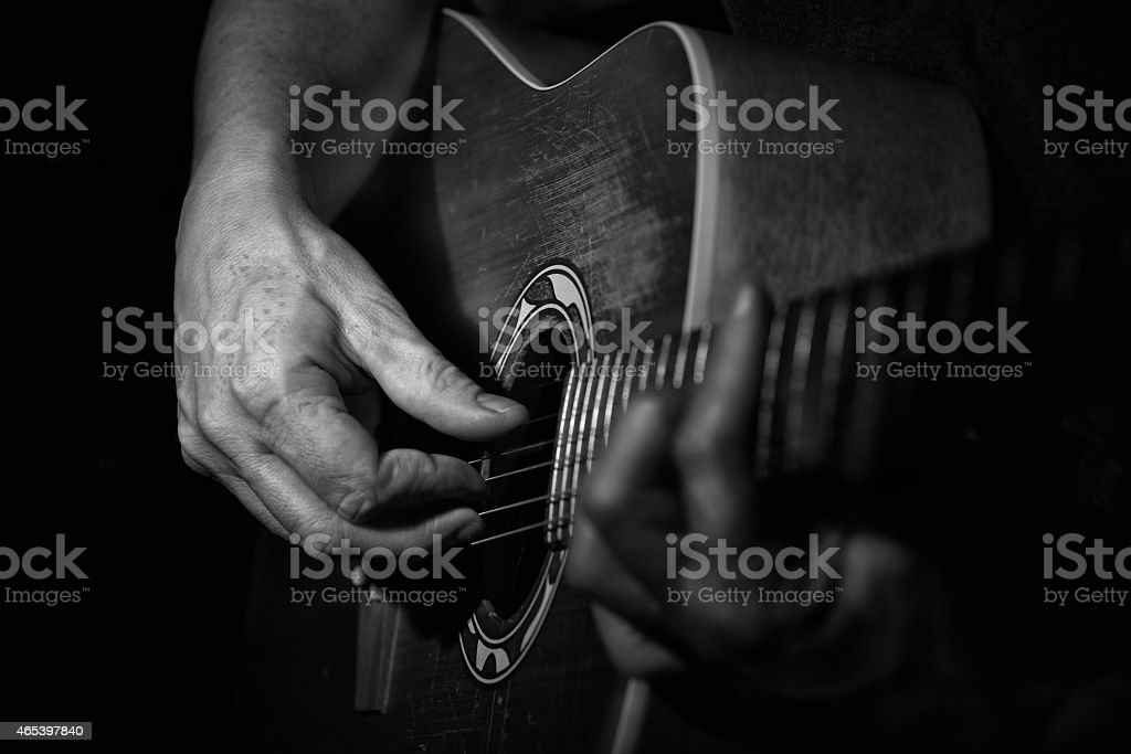 Black and white Close up of a guitarplayer stock photo