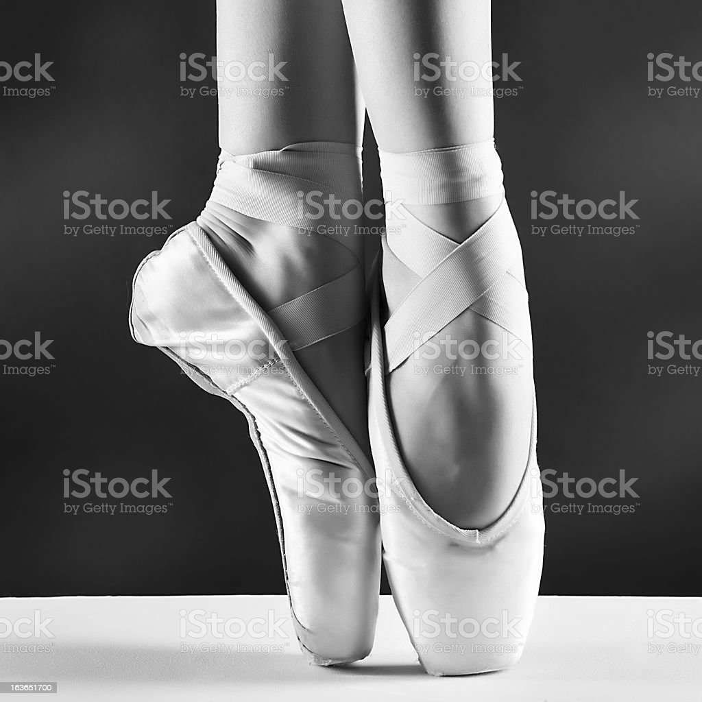 Black and white close up of ballet shoes on tiptoes stock photo