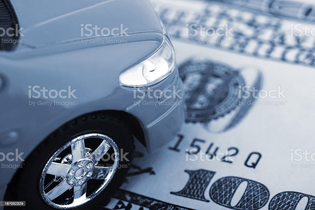 Black and white close-up of a car on money stock photo