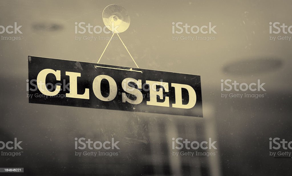 Black and white closeup of a Closed sign hanging on a window stock photo