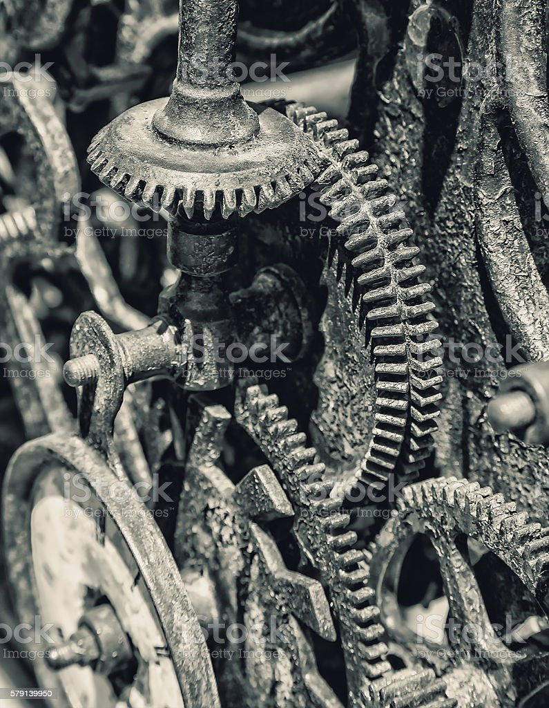 Black and white Close-up of ancient clock gears metal mechanism stock photo