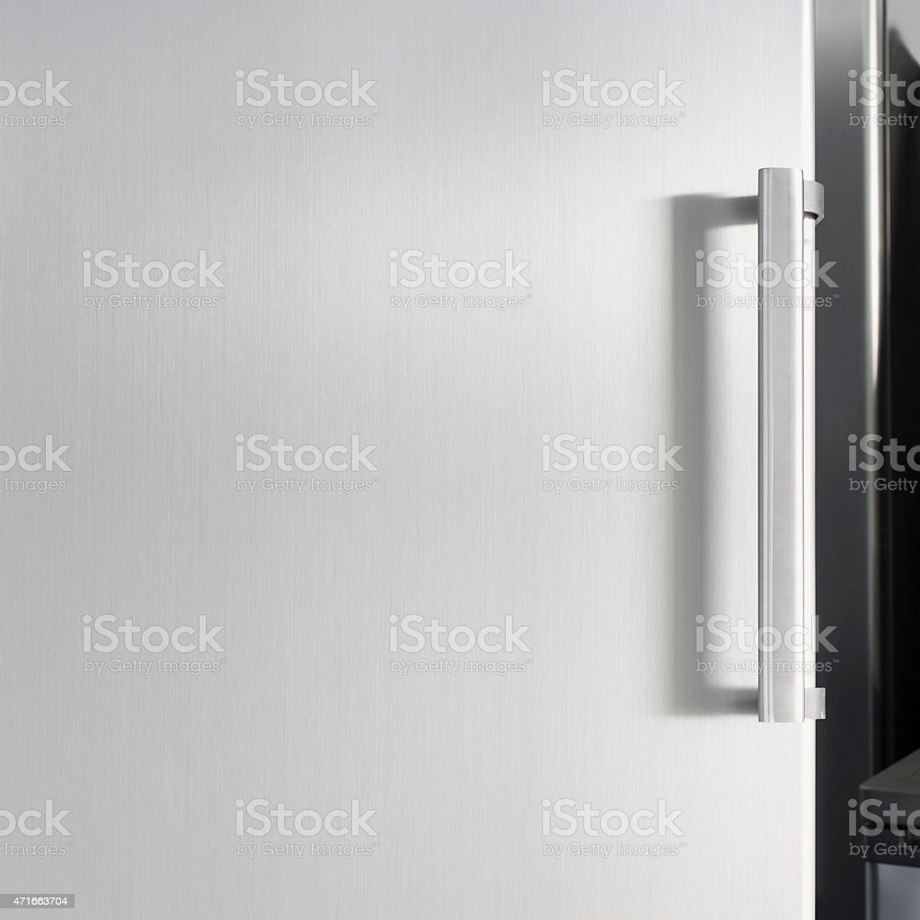 Black and white close-up of of refrigerator door and handle stock photo